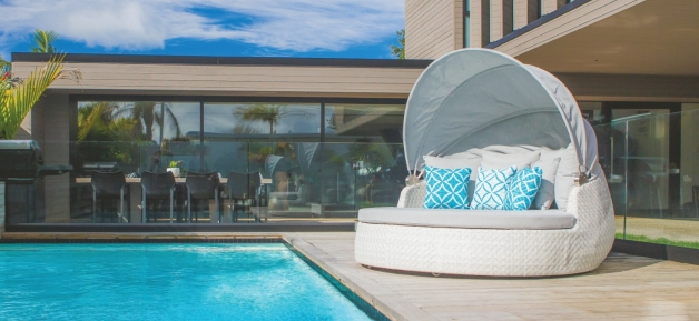 White Outdoor Daybed by pool